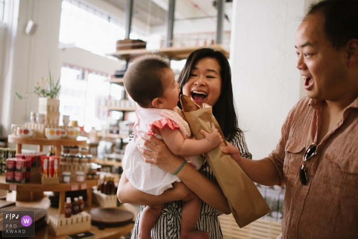 Californiafamily photographer: baby grabs a baguette to her parents' surprise