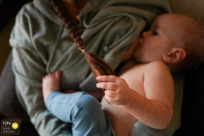 Child breastfeeding and holding onto mom's hair   Seattle, Washington mother and child photography
