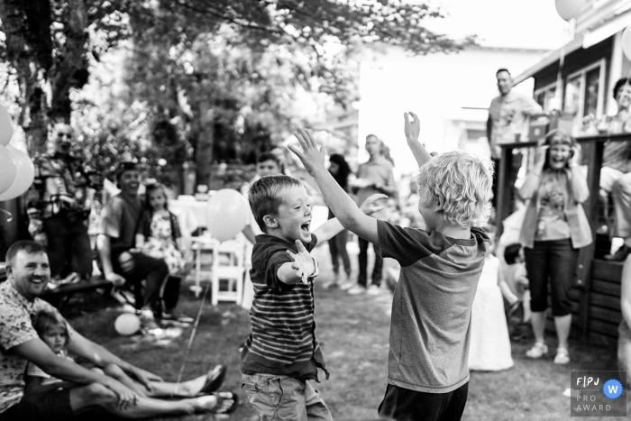 Black and white photo of kids celebrating at a party | Seattle family photography