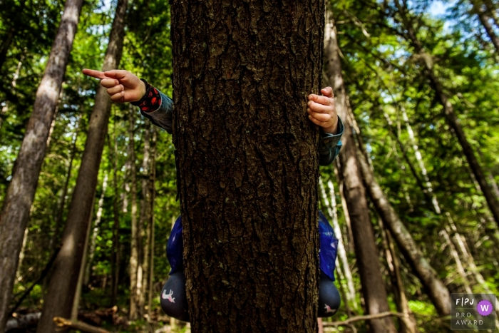 British Columbia Girl climbs tree and points from her perch