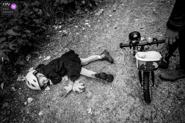 British Columbia Canada Girl lays on the bike path, done with biking.