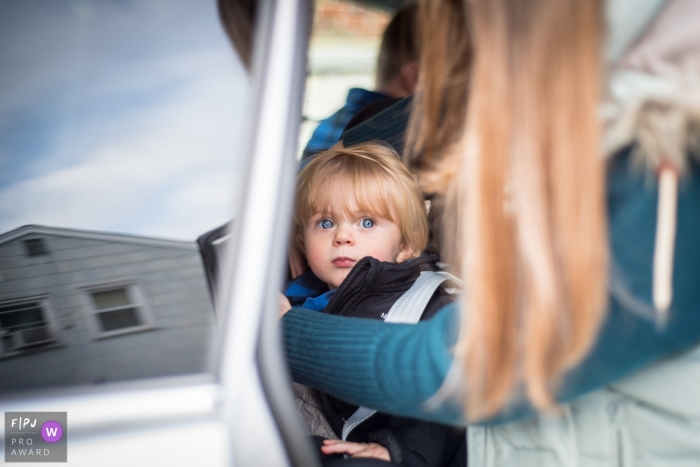New Jersey Mom getting daughter buckled into the car