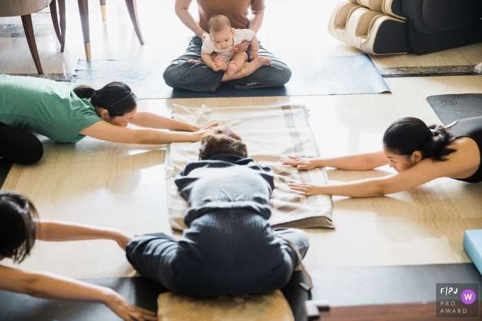 Hangzhou City Family with baby doing yoga.