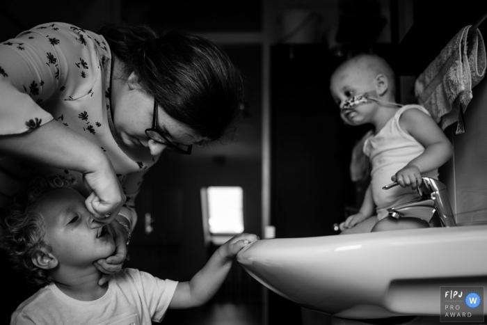 Zeeland Netherlands mom helping child - Brush those teeth