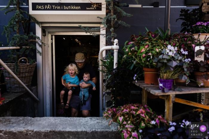 Copenhagen Denmark family leaving the local flower shop