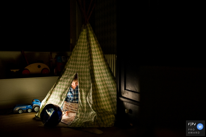 East Flanders boy inside indoor tent during a day in the life session