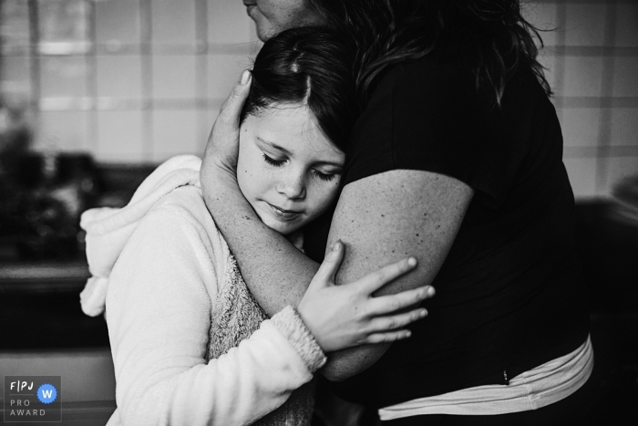 Drenthe Netherlands Girl hugging her mom after she had a fight with her brother