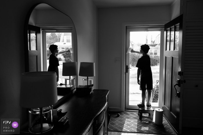 Madison Wisconsin Child washes front door window at home