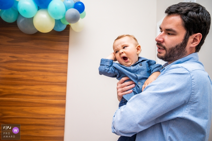 Campinas Sao Paulo father and his son at a party with blue balloons