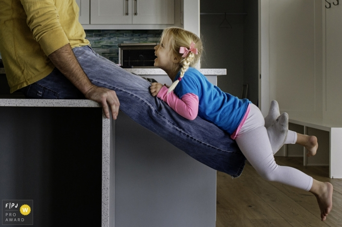 Key West Florida Leg Lifts with a young girl in the family kitchen
