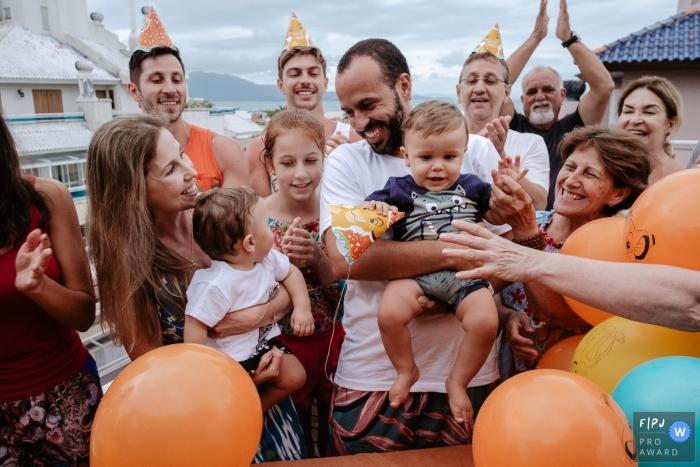 Florianopolis Santa Catarina birthday party with balloons and family outside