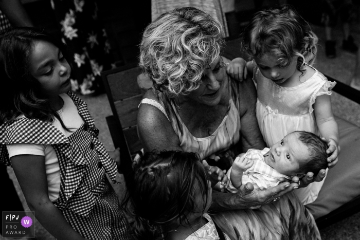Seattle grandma holding baby as other children look on