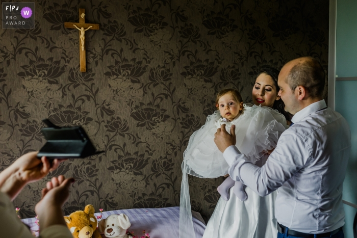 A young girl and family ready themselves for a baptism   Belgium baptism image
