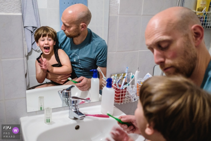 Dad waits patiently as routine of brushing teeth is never straightforward. | Germany day in the life family photography