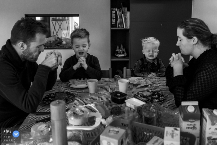 Noord Holland family prays before their meal   Netherlands Day in the Life photography
