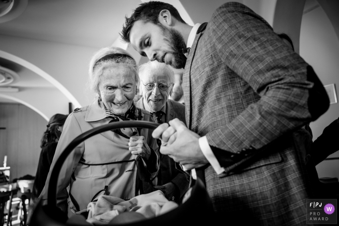 Grandma and Granddad admire their new grandbaby with the father | Overjssel Family Photographer