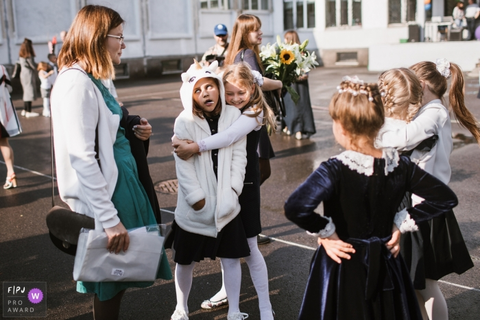 First day of school, friends come back together and hug   Russia family photo