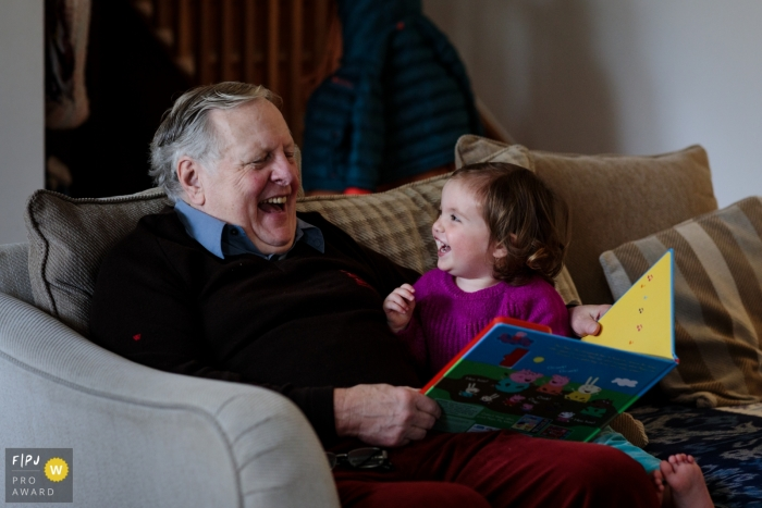United Kingdom family photo of a little girl enjoying some fun with her grandad