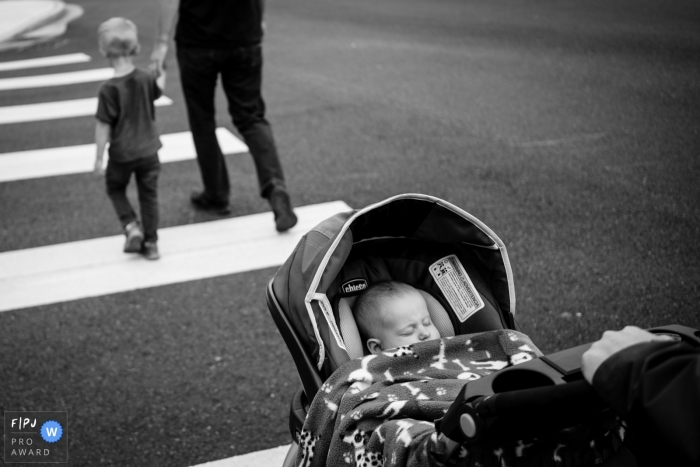 Washington family photo session | dad and kid walks across the street while mom pushes baby in stroller while baby sleeps