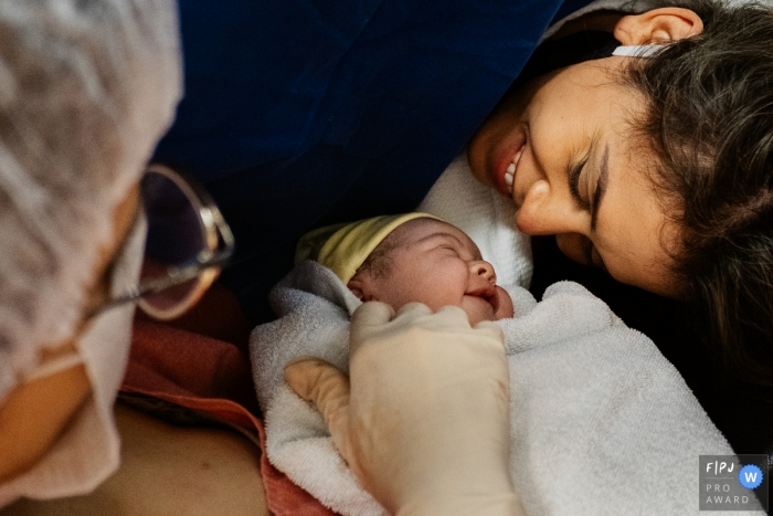 Sao Paulo birth image of smiling mom and infant with a cute smile back