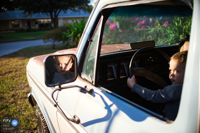 Sarasota, FL Documentary Family Photography | Little man is ready to take daddy's truck for a spin