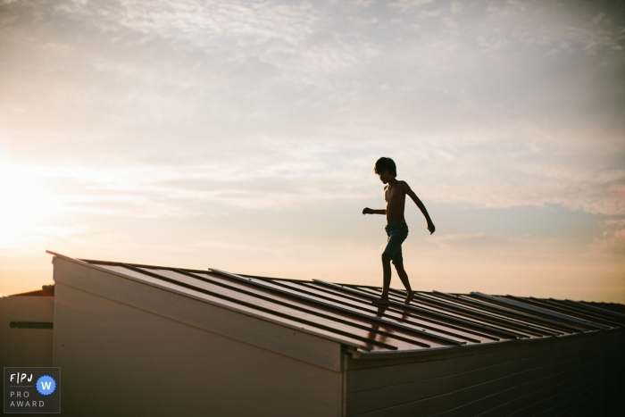 Drenthe Family image of adventures at the beach, walking across the roof of a building