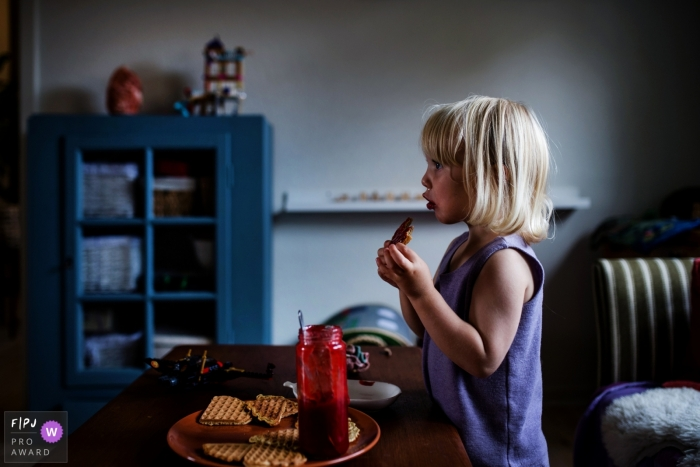 Denmark Documentary Family photo of girl eating waffles and jam