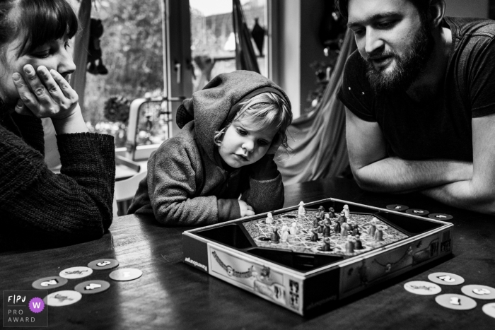 Hamburg Family playing a game on the table