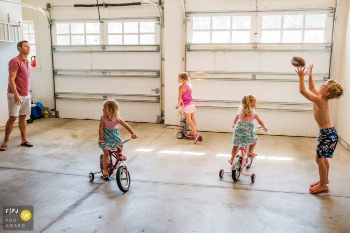 San Francisco Documentary Family image of dad and kids playing in the garage