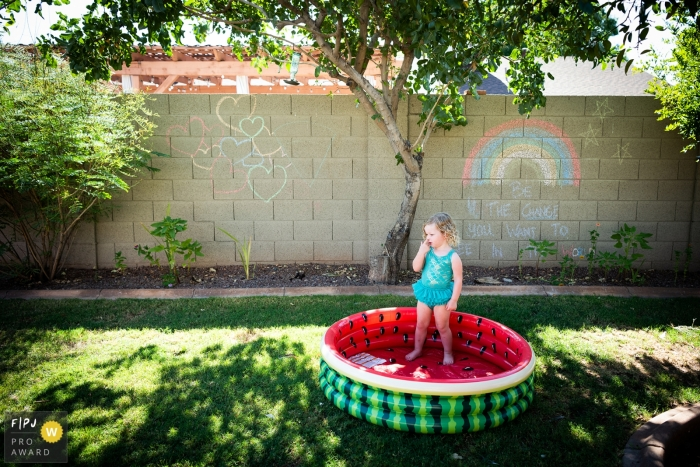 Phoenix Documentary Family Photographer | Poolside boogie pick of a young girl in her watermelon themed pool