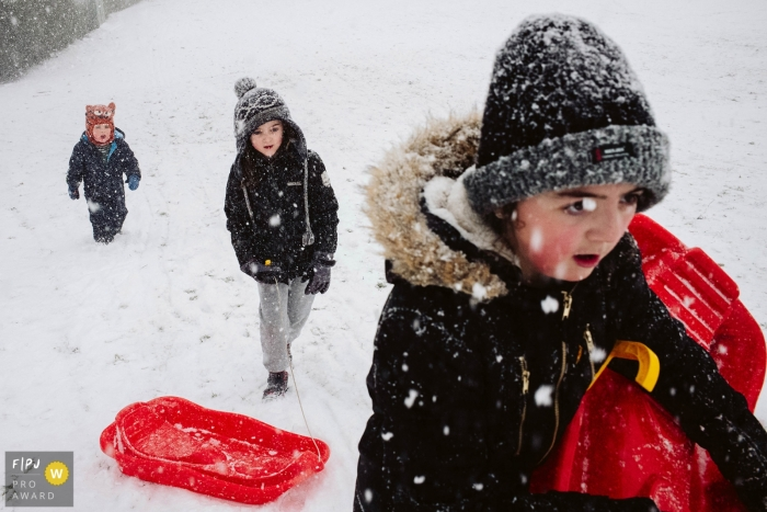 Greater Manchester Family Photographer | kids playing out in the snow with their sleds