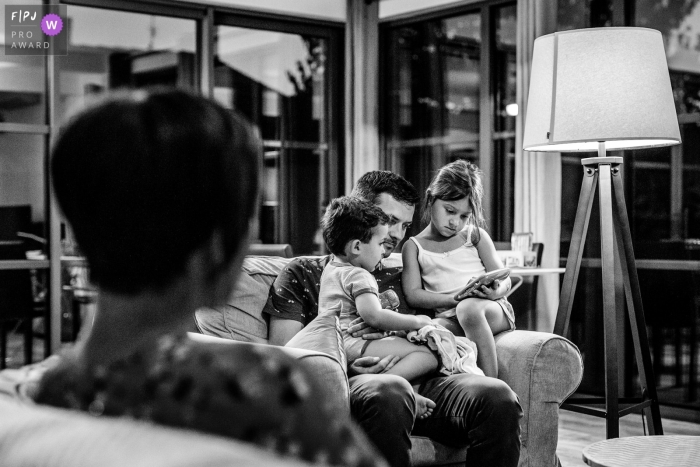 Haute-Garonne Documentary Family Image of dad reading a bedtime story to his children