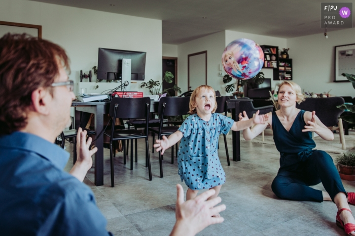 East Flanders Documentary Family Session | dad, mom, and girl play ball in the house