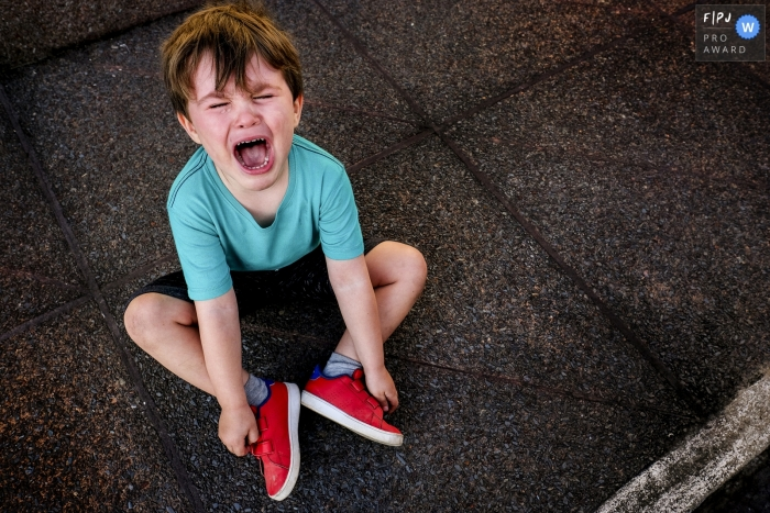 Minas Gerais Family image of a young boy not so happy, filled with tears