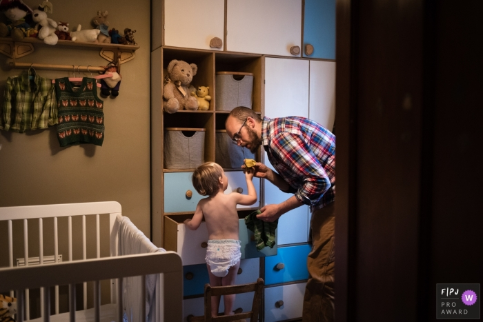 Cambridgeshire Family photography of a toddler in his drawers pulling out socks