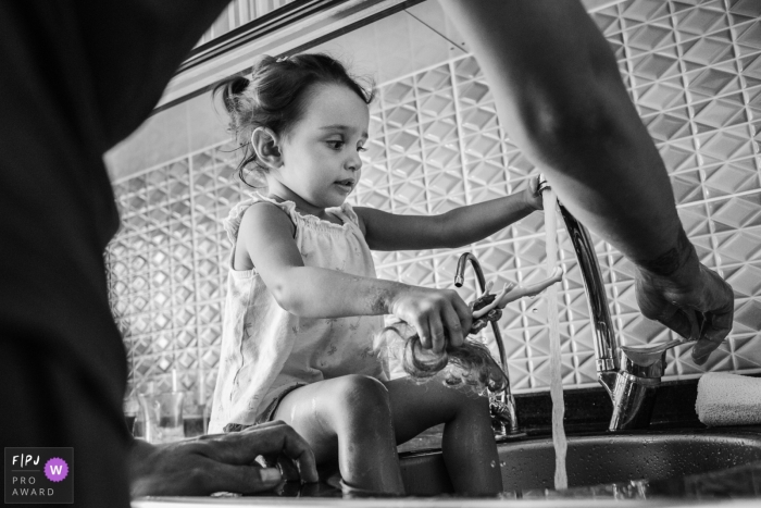 Istanbul Documentary Family Photographer | young girl gives a bath to her doll