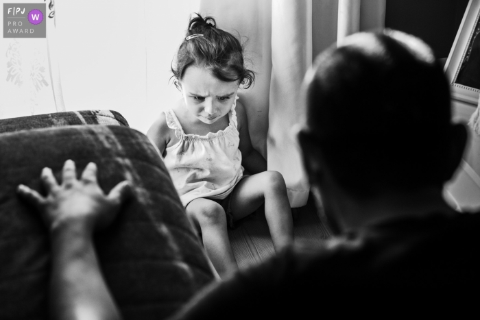 Istanbul Documentary Family photo of a sad daughter playing with her father
