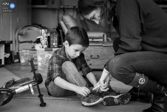 Ventura Documentary Family image of young boy learning to tie his shoes