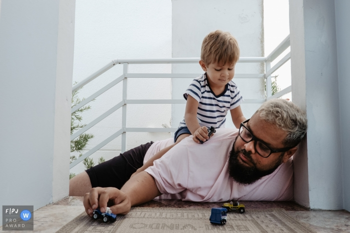 Florianopolis image of Father playing with his son with toy car