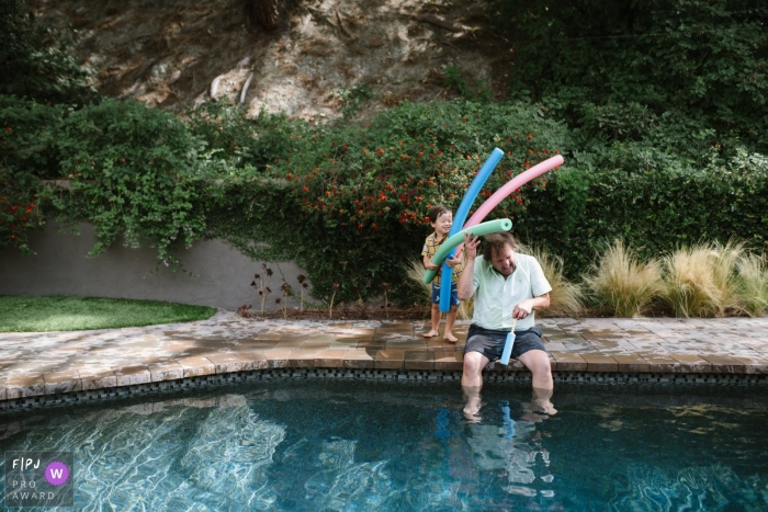 Los Angeles Documentary Family Photo | dad gets attacked by pool noodles