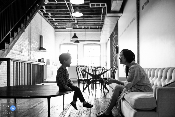 Family documentary photographer Los Angeles   mom and son have a nice talk together