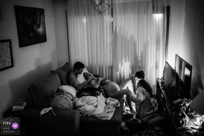 SP black and white documentary-style in-home birth photo delivery session