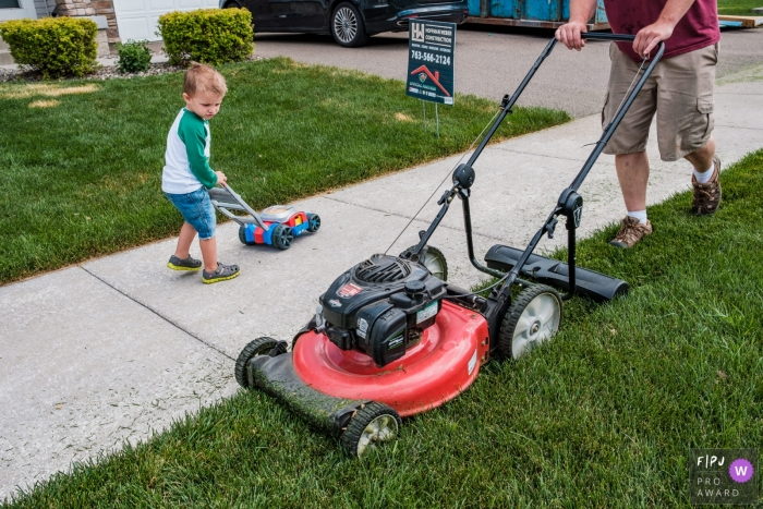 Young man mowing the lawn with Dad in this San Francisco family photo
