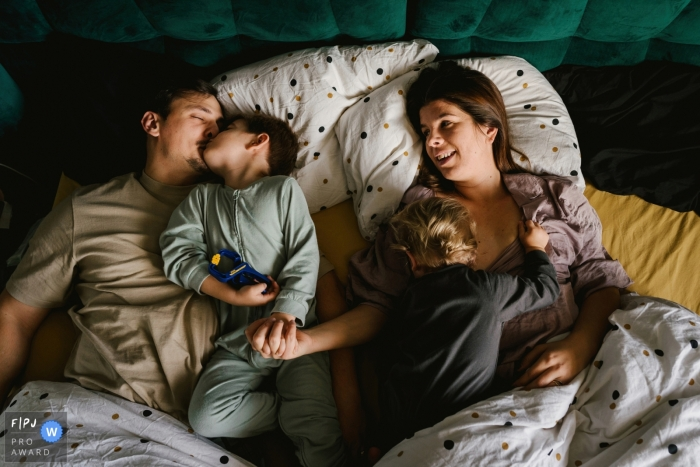 England Family in bed together - morning routines during their Bedfordshire family photo shoot