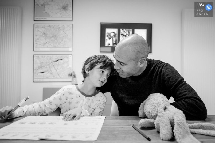 Nantes black and white father/child image shoot in the home during Homework time