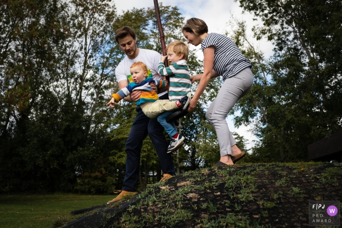 England at-home documentary-style family photo shoot in the yard with a fun zip wire