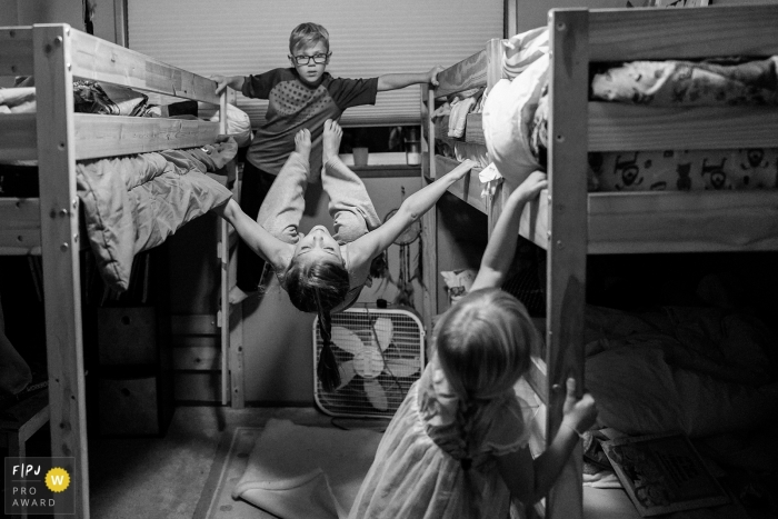 Seattle Family Photographer captures kids playing before having to go to bed