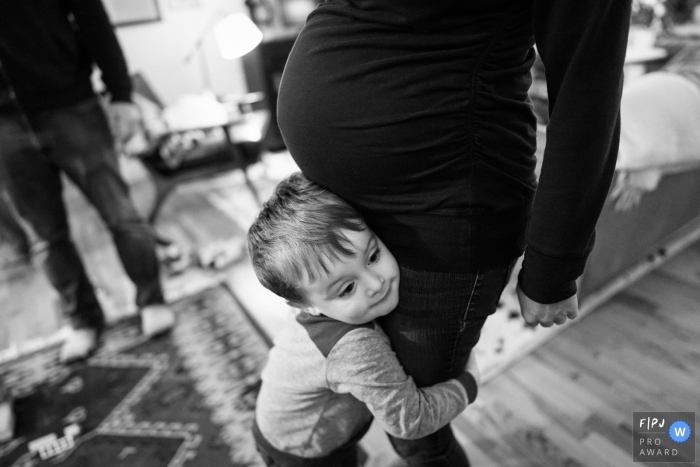 A boy hugs his pregnant momma in this Seattle Family image