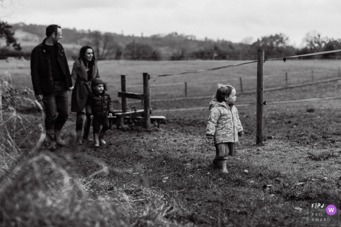 England outdoor black and white family natural photo of this family taking a stroll in front of the Surrey downs UK