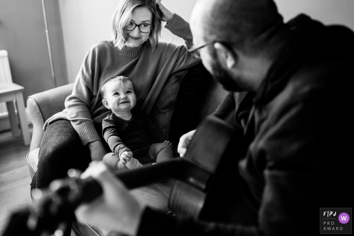England musical documentary-style family photo shoot in Norfolk as a father serenades his baby girl